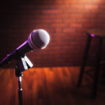 a microphone in a comedy club