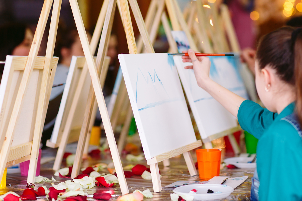 painting on an easel in an art class